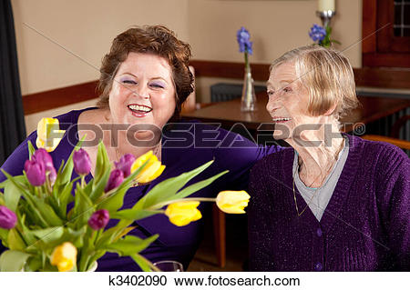 Stock Photography of Mature woman with her 80 year old mother ... banner free