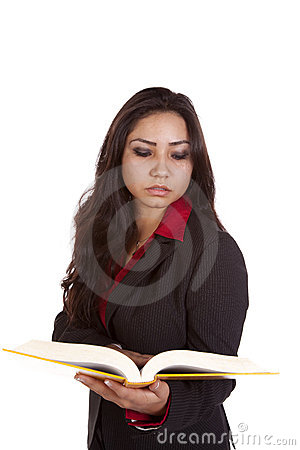 A girl holding a book. Serious royalty free stock