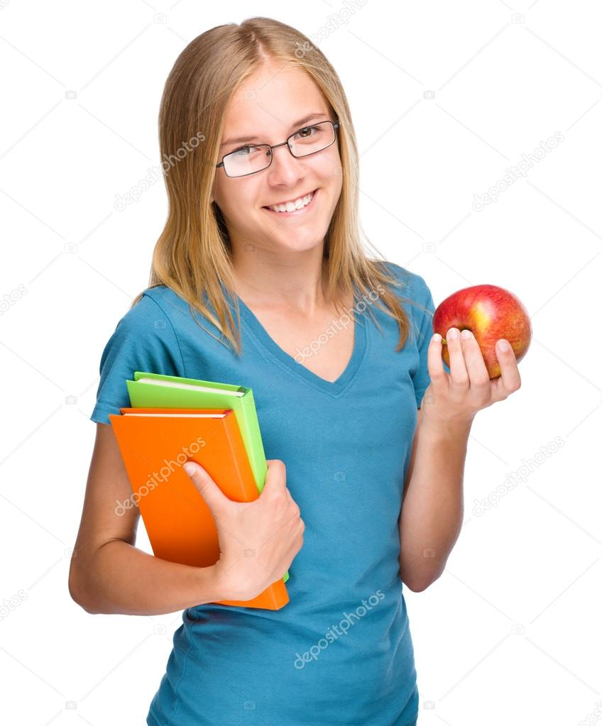A girl holding a book black and white library Young student girl is holding book and apple — Stock Photo ... black and white library