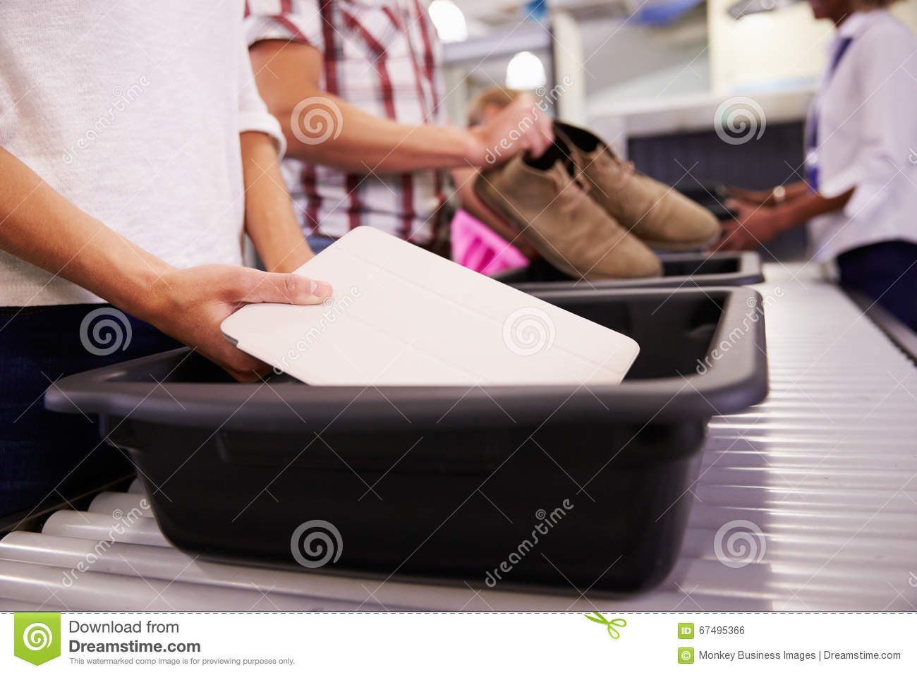 Angry man checks into airport clipart freeuse download Man Puts Digital Tablet Into Tray For Airport Security Check Stock ... freeuse download