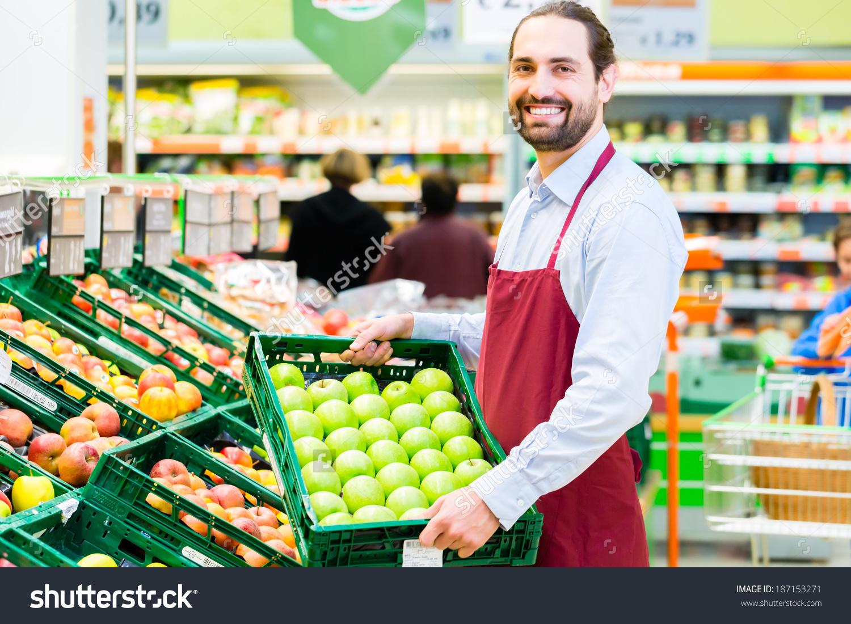 Apple clipart clerk jpg free Supermarket Clerk Filling Apple Storage Racks Stock Photo ... jpg free