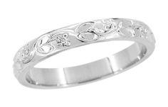 Light scattering wedding rings. Art deco engraving patterns