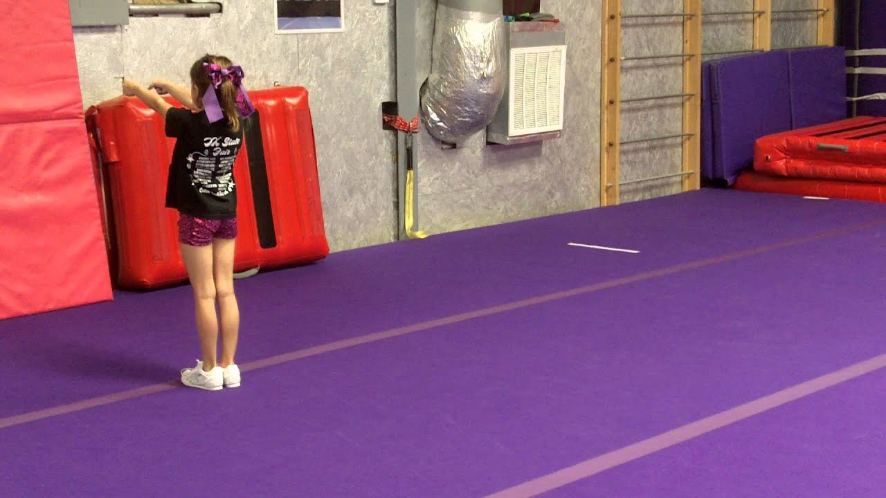 Courage Cheer and Dance United - Shalynn Back handspring stepout Roundoff  handspring tuck royalty free