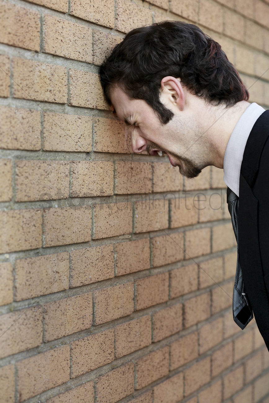 Beating my head against the wall clipart jpg black and white library Businessman banging his head against the wall Stock Photo - 1676449 ... jpg black and white library