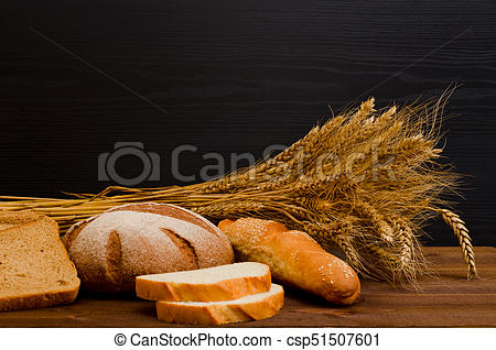 Black and white rye bread baking clipart vector freeuse stock White and rye bread, a loaf, a sheaf on wooden table, black background,  space for text vector freeuse stock