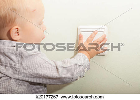 Boy turning lights of clipart free library Picture of Baby boy child kid turning on the light. k20177267 ... free library