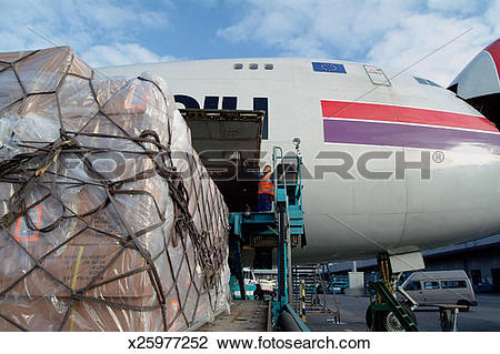 Cargo plane loading clipart banner royalty free library Stock Photo of Man Overseeing the Loading of Freight into a Cargo ... banner royalty free library