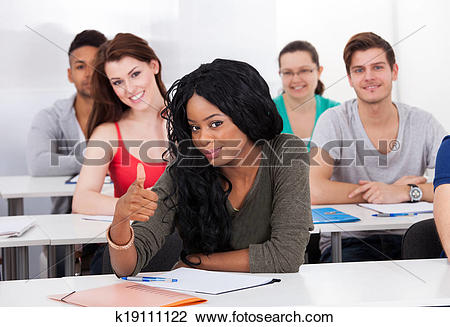 Classroom thumbs up clipart clip library download Stock Photo of Confident Student Gesturing Thumbs Up In Classroom ... clip library download