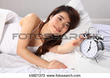 Clipart woman turning off alarm free Stock Photo of Woman in bed reach for alarm clock k5821373 ... free