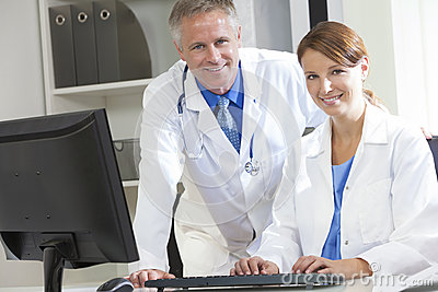Computer in hospital clipart picture royalty free Male Female Hospital Doctors Using Computer Royalty Free Stock ... picture royalty free