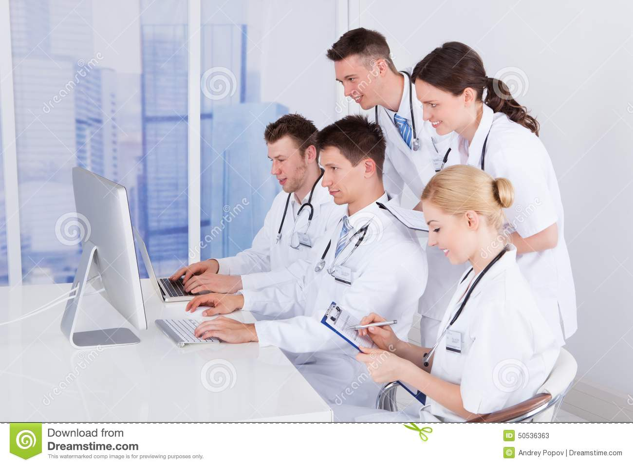 Computer in hospital clipart vector black and white library Group Of Doctors Working Together Stock Photo - Image: 46840644 vector black and white library