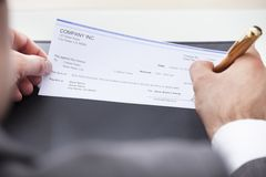 Filled cheque clipart png library stock Person Filling Cheque Stock Photos, Images, & Pictures - 14 Images png library stock