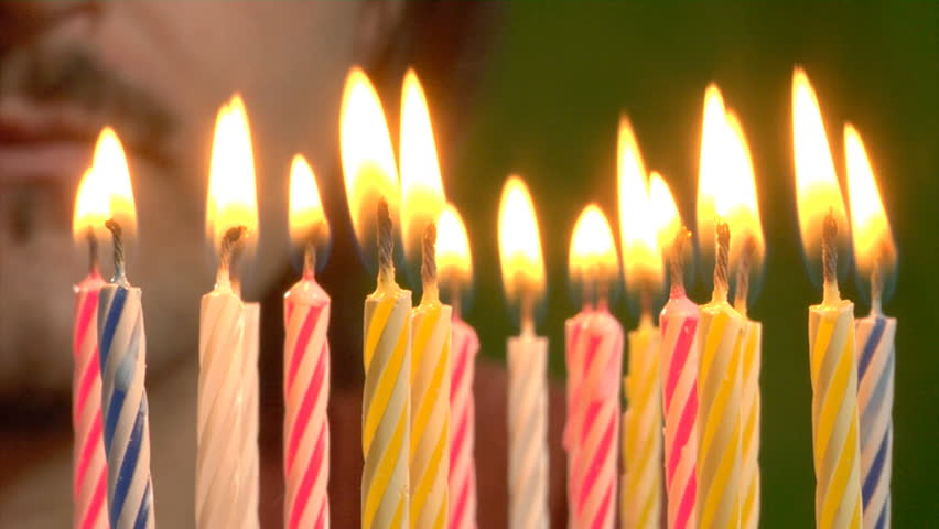 Flickering birthday candle clipart image freeuse download Flickering Candles Raise Into Frame And Happy Birthday Is Written ... image freeuse download