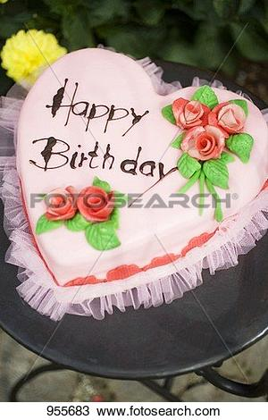 Garden birthday cake clipart banner royalty free library Stock Photo of Pink heart-shaped birthday cake on garden table ... banner royalty free library