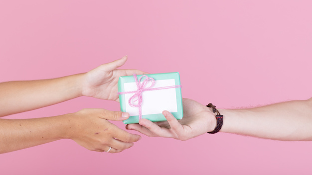 Hands passing a gift clipart picture Man\'s hand giving gift to her woman against pink background Photo ... picture