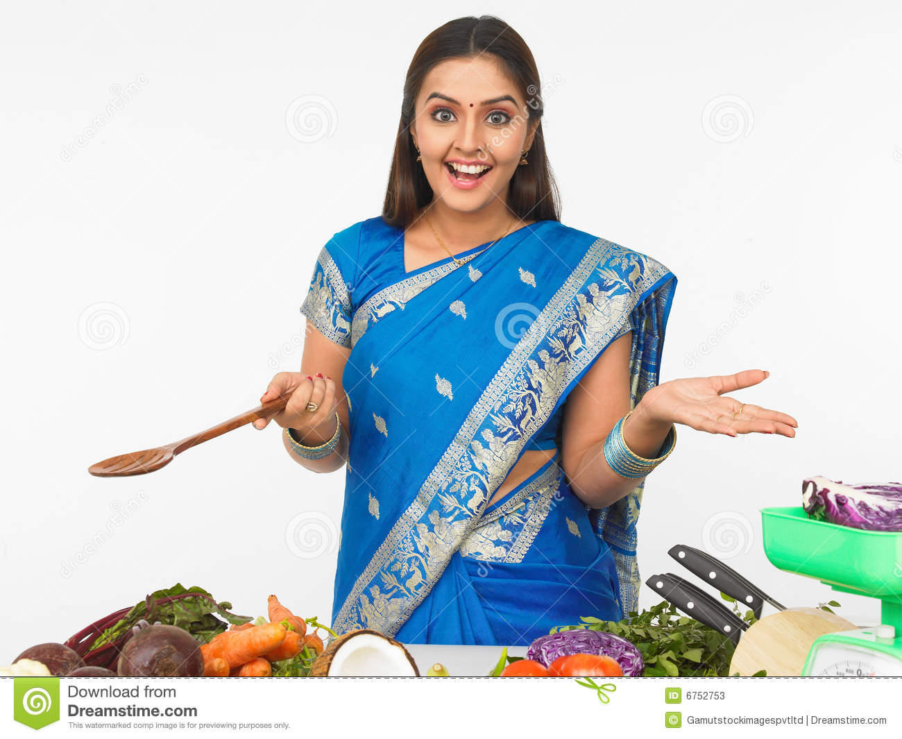 Indian lady chef clipart image freeuse Indian Woman Cooking Stock Photos, Images, & Pictures - 734 Images image freeuse