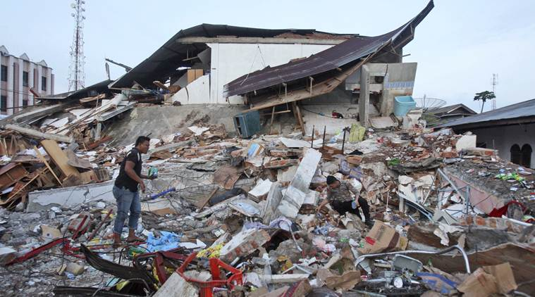 Indonesia earthquake svg freeuse library Rescuers comb Indonesia earthquake rubble for second day | The ... svg freeuse library