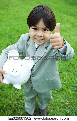 Little boy giving thumbs up clipart clip art freeuse stock Stock Photo of Little boy dressed in full suit holding piggy bank ... clip art freeuse stock