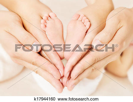 Love feet clipart jpg clip free stock Stock Photography of Newborn baby feet in parents hands. Love ... clip free stock