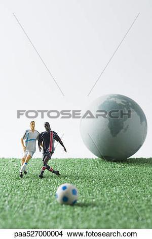 Miniature soccer ball clipart vector stock Stock Photo of Miniature soccer players chasing soccer ball, globe ... vector stock