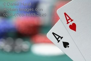 Pair of aces heart and spade clipart freeuse stock Stock Photo of a Pair of Aces With Poker Chips in Background freeuse stock