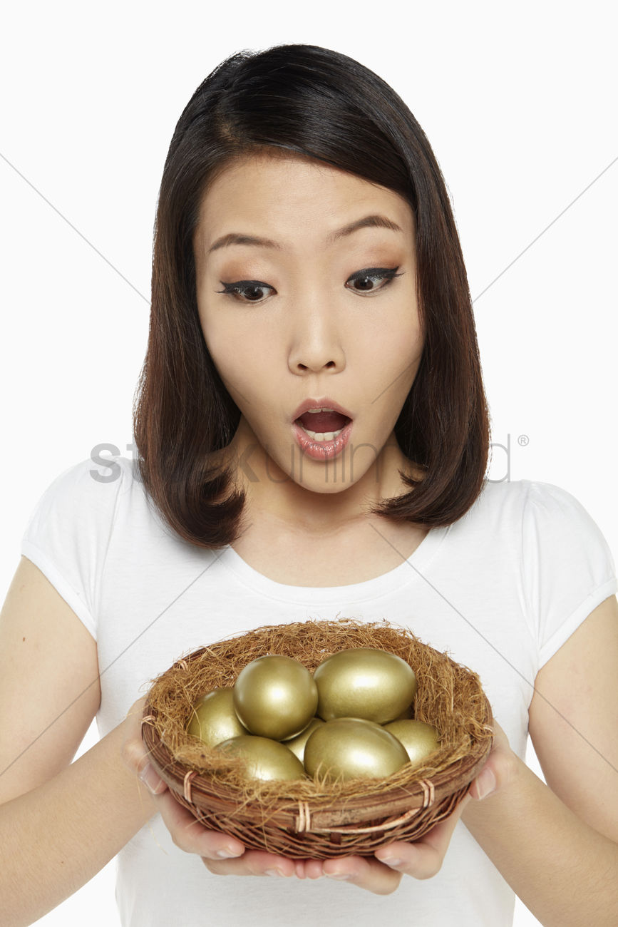 Person holding a lot of eggs clipart black and white library Woman holding a nest filled with gold eggs, looking shocked ... black and white library