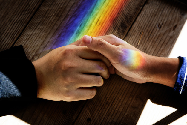 Picture of a man holding a prism clipart free stock Hands hold together with prism lights Photo   Free Download free stock