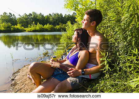 River bank state park logo clipart clip art royalty free Stock Image of Young couple sitting on canal bank, Delaware Canal ... clip art royalty free