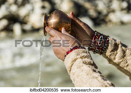 River pray clipart vector transparent download Stock Image of A female pilgrim praying, offering the holy water ... vector transparent download