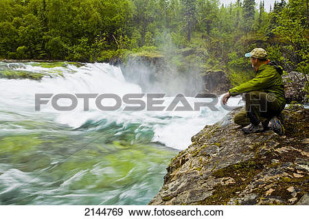 Riverbank state park logo clipart graphic library stock Stock Photograph of Hiker Kneels On The Riverbank At The Brink Of ... graphic library stock
