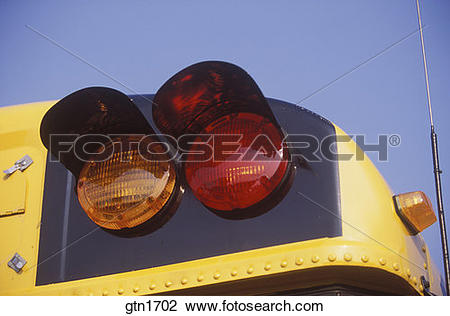 School bus flashing yellow light clipart clipart Stock Photo of Tight shot of the flashing red and yellow lights on ... clipart