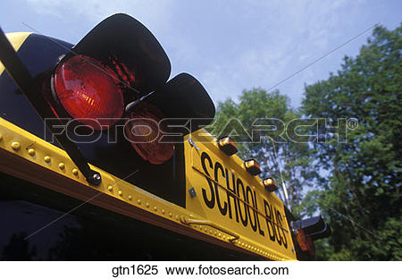 School bus flashing yellow light clipart picture stock Stock Image of Tight shot of the flashing red and yellow lights on ... picture stock
