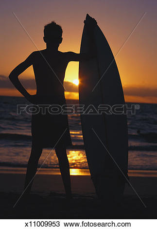 Silhouette boy surfboard clipart svg free download Stock Photo of silhouette of a teenaged boy holding a surfboard on ... svg free download