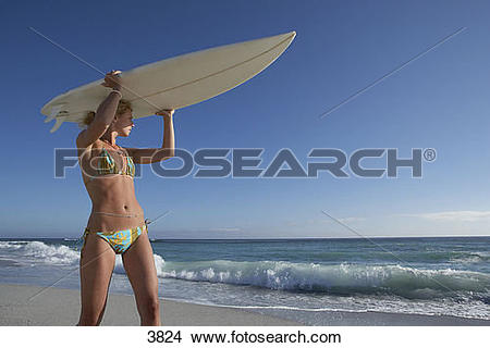 Surfboard on head clipart clip art transparent download Stock Photo of Young woman in bikini standing on beach, carrying ... clip art transparent download