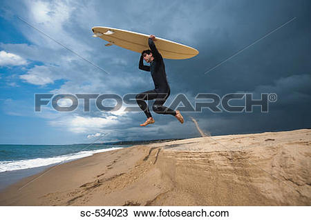 Surfboard on head clipart clip black and white library Stock Photo of Surfer carrying surfboard on head and jumping up in ... clip black and white library