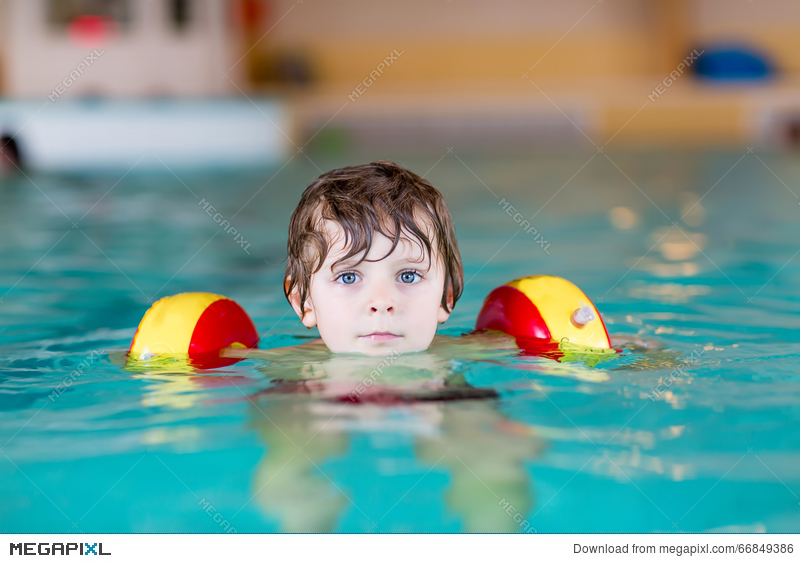 Swimmies clipart graphic Little Kid Boy With Swimmies Learning To Swim In An Indoor ... graphic