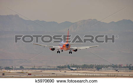 Vegas plane clipart png royalty free download Stock Photography of Colorful Commercial Plane Landing in Las ... png royalty free download