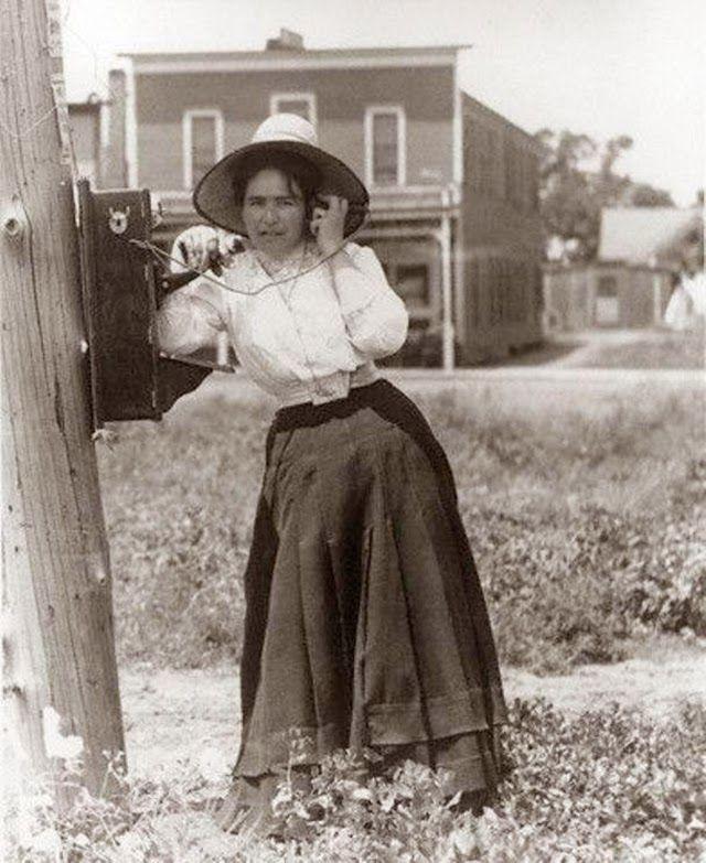 Victorian clipart crank transparent download Woman talking on a hand crank oak telephone, 1900   Vintage ... transparent download