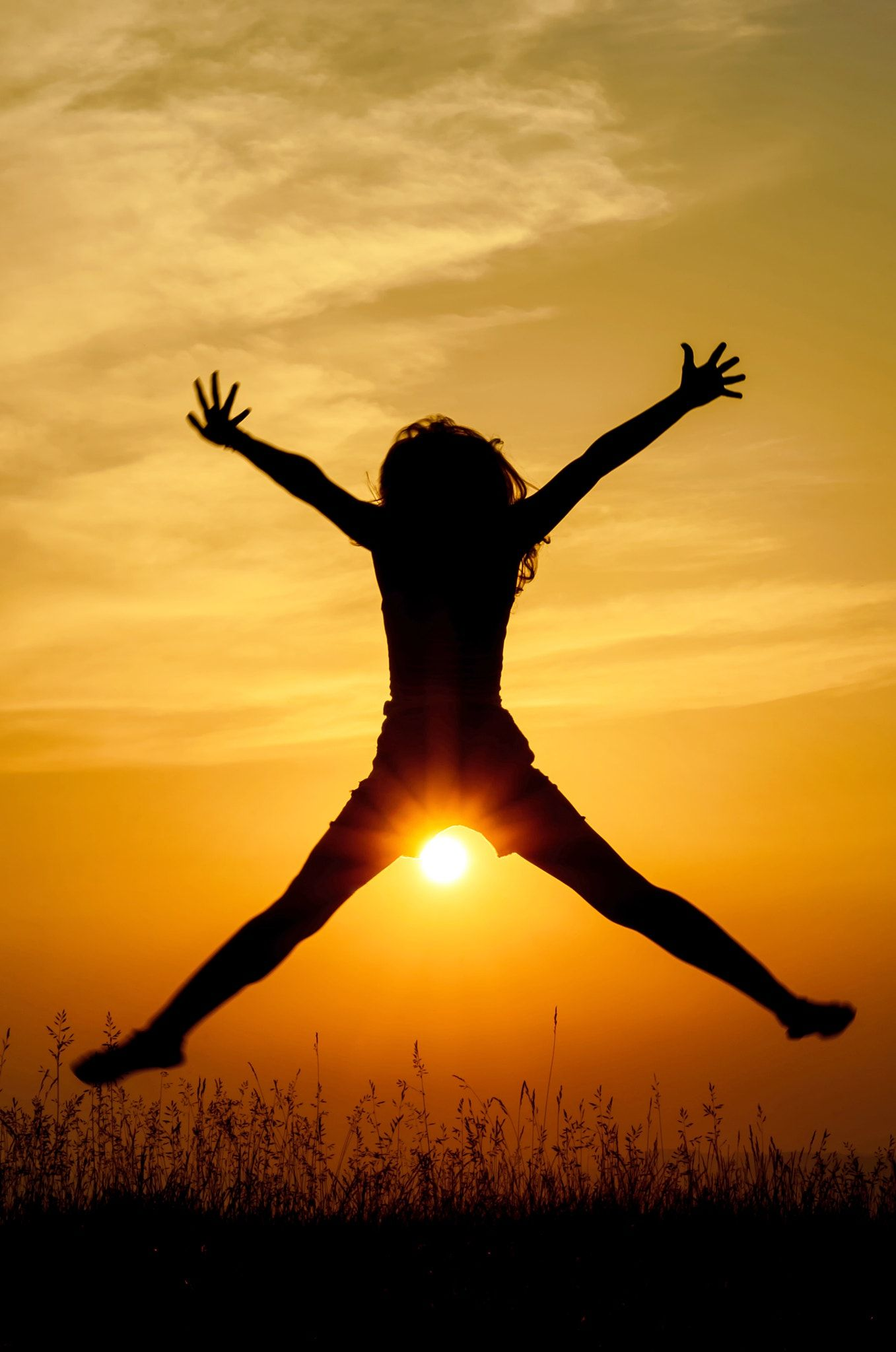 Woman jumping clipart sunset clip transparent stock joy in the sunset - silhouette of a girl jumping of joy in ... clip transparent stock